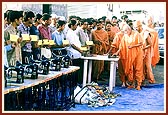 To revive the livelihoods of the earthquake victims Swamishri distributes handcarts, sewing machines and instruments for goldsmiths and cobblers