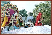 Shri Harikrishna Maharaj and Shri Radha Krishna Dev in a decorated float